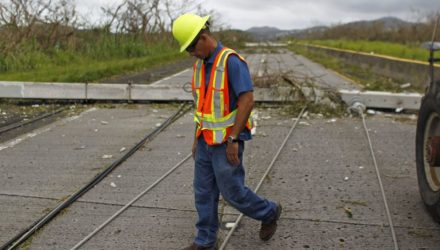 a-puerto-rico-power-authority-worker-walks-between-downed-power-lines-in-the-aftermath-of-hurricane-maria-4375